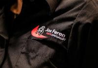 Jos Feron - Logo van Jos Feron op een hemd